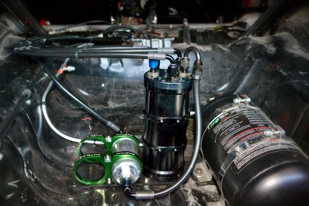 Radium FST installed in the rear wheel well.